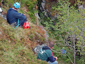 A rescuer reaches Bill and carefully puts him in a hauling bag (Pic: Kelvin Lake)