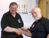 Anthony Rich (left) receiving his BCRC long service award from Bill Whitehouse (right), BCRC Chair)