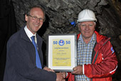 Paul Taylor, Chairman of Gloucestershire CRG (left) presenting John Smith (right) with his 50 year long service award.