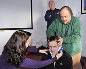Fitting a neck collar during the First Aid sessions